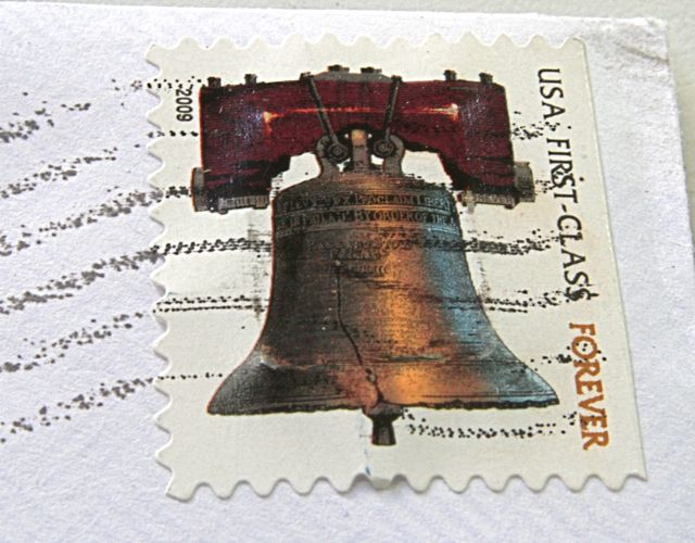 Postage stamp with a memory chip under it